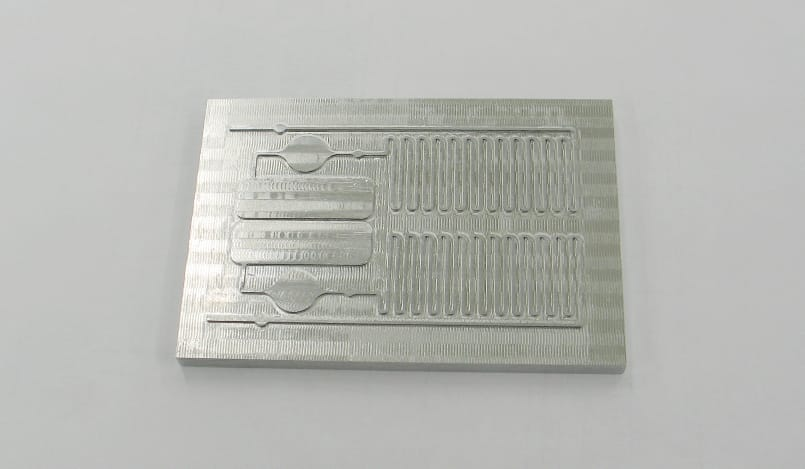 Manufacture of moulds for the production of disposable microfluidic cartridges
